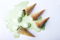 Green tea ice cream cones dropped upside down Royalty Free Stock Photo