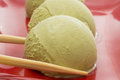 Green tea ice cream on red dish with chopsticks Royalty Free Stock Photography