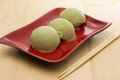 Green tea ice cream on red dish with chopsticks Stock Photography