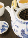 Green Tea leaves In a Tea pot with Cups Royalty Free Stock Photo