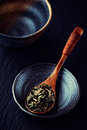 Green tea leaves on wooden spoon Stock Image