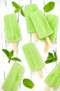 Green tea matcha mint popsicles with chocolate and coconut milk. Royalty Free Stock Photo