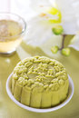 Green tea mooncake snowy skin mooncakes traditional chinese mid autumn festival food the chinese words on the mooncakes means with Stock Image