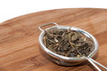 Green tea in tea strainer on the wooden board Stock Photography