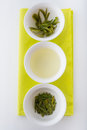 Green tea in three forms dry infusion and leaves after brewing tasting loose fusion part of traditional chinese ceremony Stock Images
