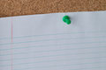 Green Thumb Tack Holding Paper on Cork Board Royalty Free Stock Photo