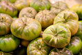 Green tomatoes at a market Royalty Free Stock Photo