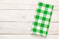 Green towel over wooden kitchen table Royalty Free Stock Photo