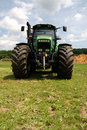 Green tractor on grass Royalty Free Stock Image