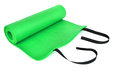 A green training mat rolled in on white background Stock Photos
