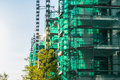 Green Translucent Covered Scaffolding Building Project Sunset Royalty Free Stock Photo