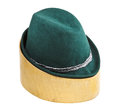 Green tyrolean felt hat on linden wooden block isolated white background Royalty Free Stock Images