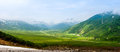Green valley surrounded by mountains located at kamchatka russia during the sunrise Stock Images