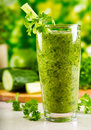 Green vegetable juice with fresh celery Royalty Free Stock Photo
