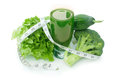 Green vegetable smoothie tape measure wrapped around a refreshing juice Royalty Free Stock Image