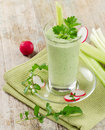 Green vegetable smoothie on a wooden table selective focus Stock Photo
