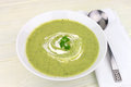 Green vegetable soup a bowl of made of peas and zucchini Royalty Free Stock Photography
