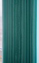 Green vertical textile window blinds. Royalty Free Stock Photo