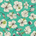 Green vintage hibiscus flowers and buds seamless repeat pattern with textured background. Perfect for fabric, clothing, pac Royalty Free Stock Photo