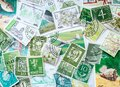 Green vintage postmarks, stamp collecting. The hobby and philately concept. Royalty Free Stock Photo