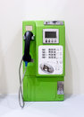 Green vintage public pay phone Royalty Free Stock Photo