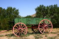 Green Wagon with Red Wheels Stock Images