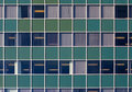 Green wall with windows Royalty Free Stock Photo