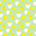 Green wallpaper with yellow chickens  in different poses and eggs. Royalty Free Stock Photo