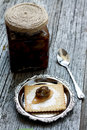 Green walnut jam wlanut with butter and biscuits Royalty Free Stock Photography