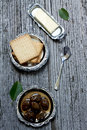 Green walnut jam wlanut with butter and biscuits Stock Images