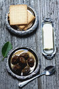 Green walnut jam wlanut with butter and biscuits Royalty Free Stock Image