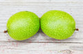 Green walnuts on wooden board Stock Images