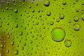 Green water drop on background Stock Photography