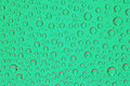 Green water drops background close up Stock Photo