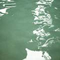 Green water small waves on the of a pool Royalty Free Stock Photography