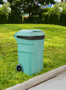 Green wheelie bins for general waste and garden organics large Stock Photo