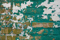 Green and White Paint Peeling off Yellow Brick Wall Royalty Free Stock Photo