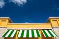 Green and white rooftop on blue sky Royalty Free Stock Photo