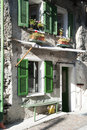 Green windows in old facade house Royalty Free Stock Photo