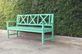 Green wooden bench and green leaves wall Royalty Free Stock Photo