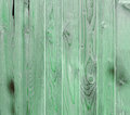 Green wooden fence, close up, texture, background. Natural wood. Vertical bars Royalty Free Stock Photo