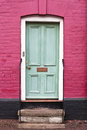 Green wooden front door english house Royalty Free Stock Image