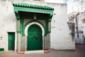 Green wooden gate of ancient mosque morocco in medina tangier Stock Photo