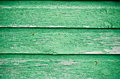 Green wooden wall with worn paint Stock Photo