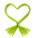 Green wool scarf heart shape knitted on white background Royalty Free Stock Image
