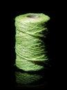 Green yarn coil of in dark reflective back Stock Photos