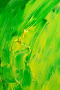 Green and yellow background globs of thick paint applied to a canvas to create a texture Stock Photos
