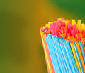 Green yellow blue pink red colored straws group this represents concept of holiday picnic outing and other travel concepts Royalty Free Stock Photography