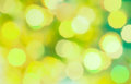 Green and yellow colored Christmas bokeh light abstract holiday background. Royalty Free Stock Photo
