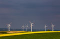 Green and yellow fields with Wind turbines generating electricit Royalty Free Stock Photo